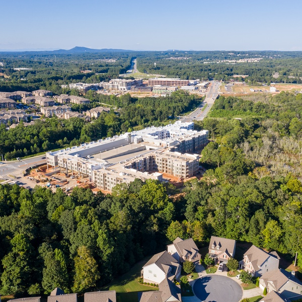 Aerial view new apartment construction in Atlanta suburbs next to highway