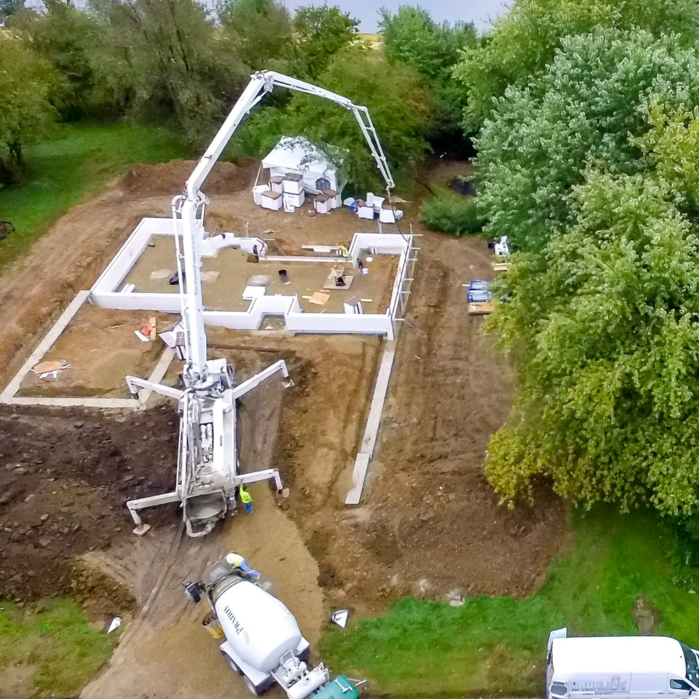 Pumping Concrete into a New Home's Walls