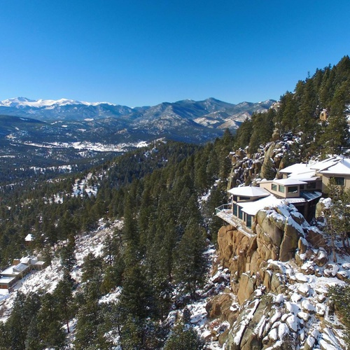 Mt. Evans, with Bear Lodge in the foreground, on the cliff.