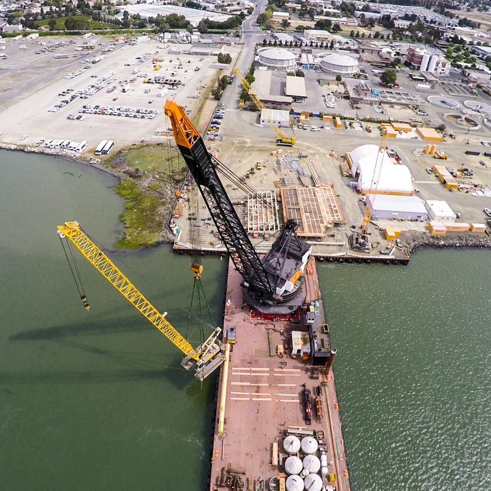 Loading crane onto barge for transport