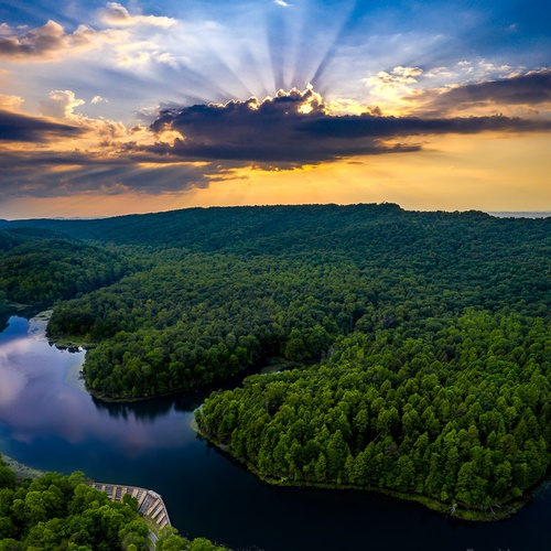 """A scenic """"beauty/hero"""" shot of a local park with a stone dam that w..."""