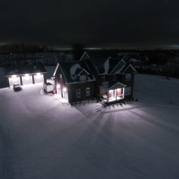 Snowy house at night