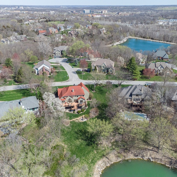 Large Home in Kansas City by a lake - aerials show the lake and home