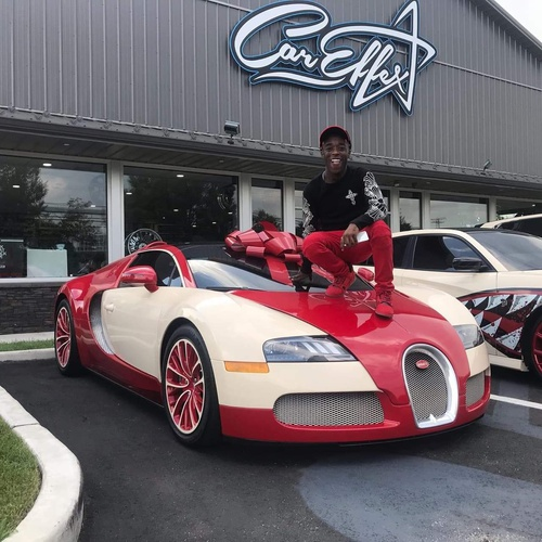 Photo shoot of famous rapper picking up his Bugatti