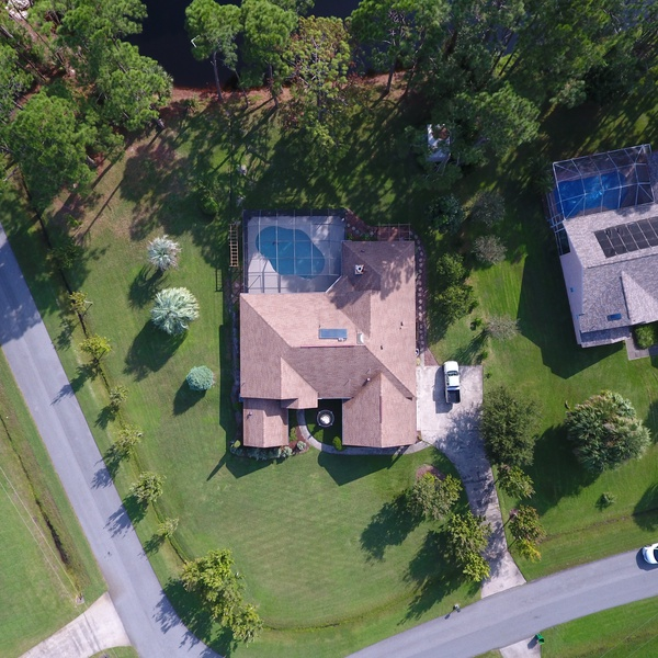 House with pond bird's eye view
